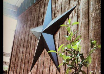 Metal Star on Barn Wall