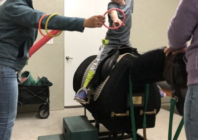 child riding equicizer in office